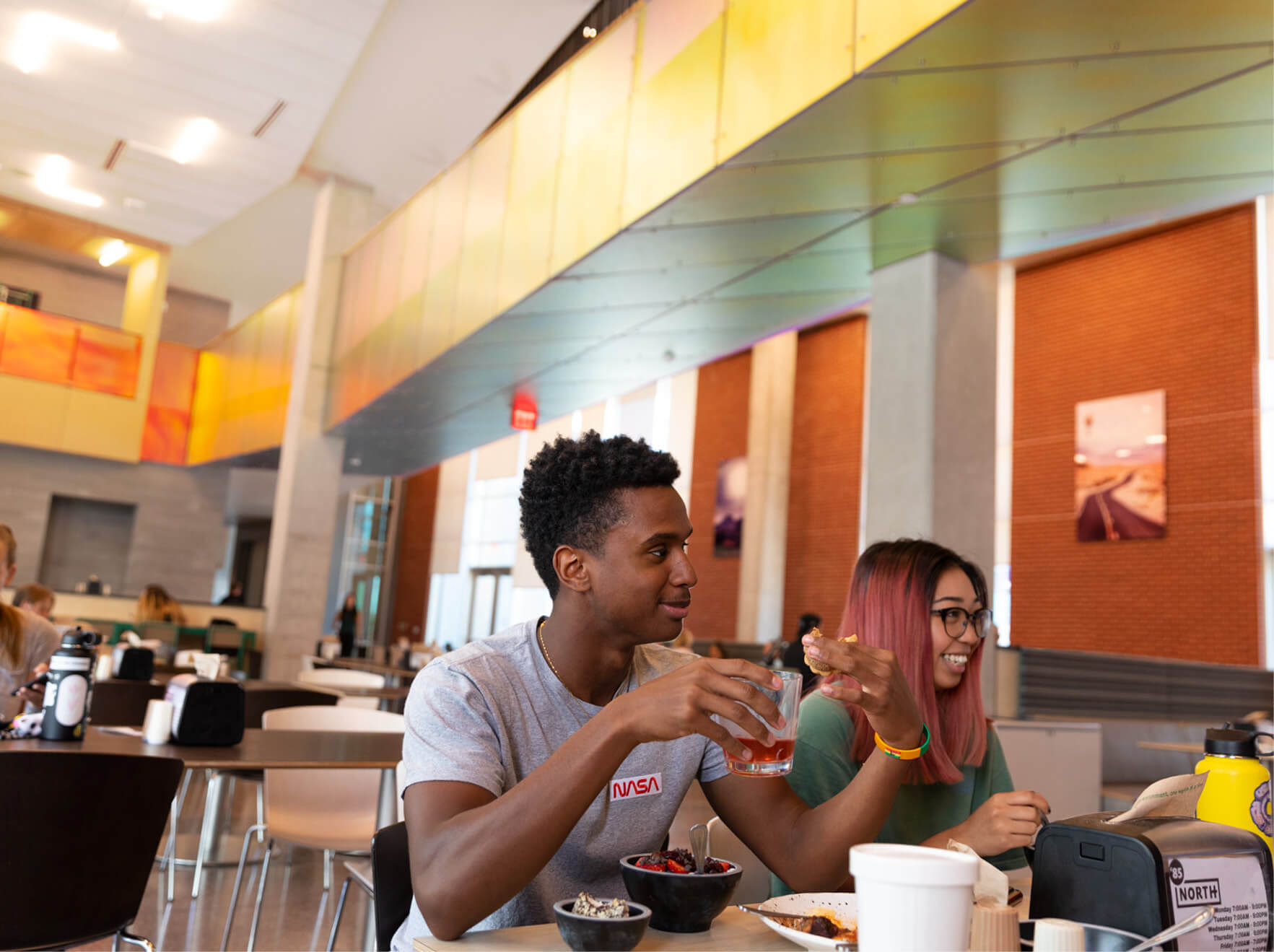 Students enjoying their meal at the honors village cafeteria