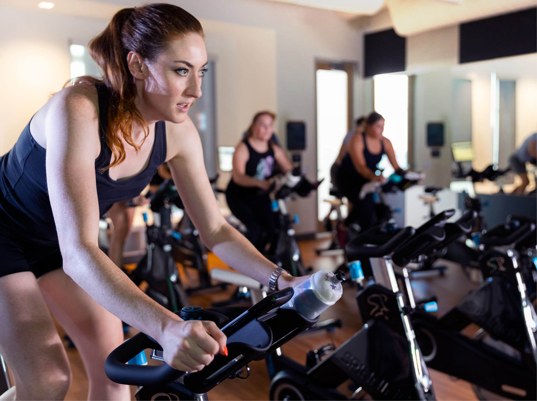 Student doing a spin class at the North Rec