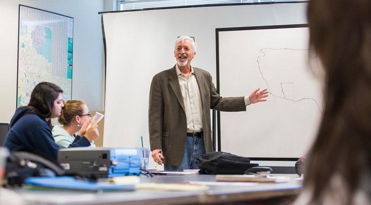 Teacher in front of white board