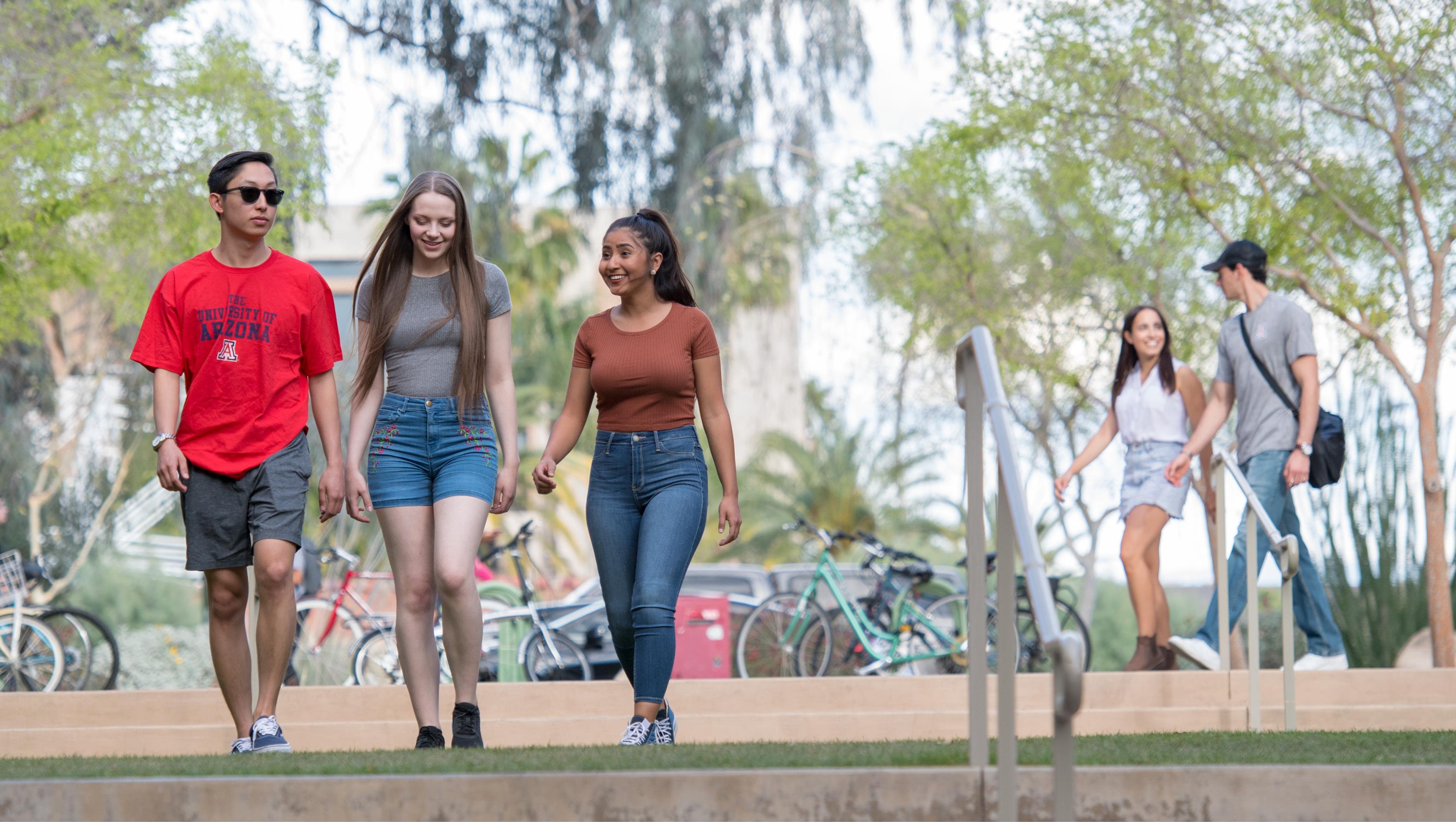 Three students in casual wear walking