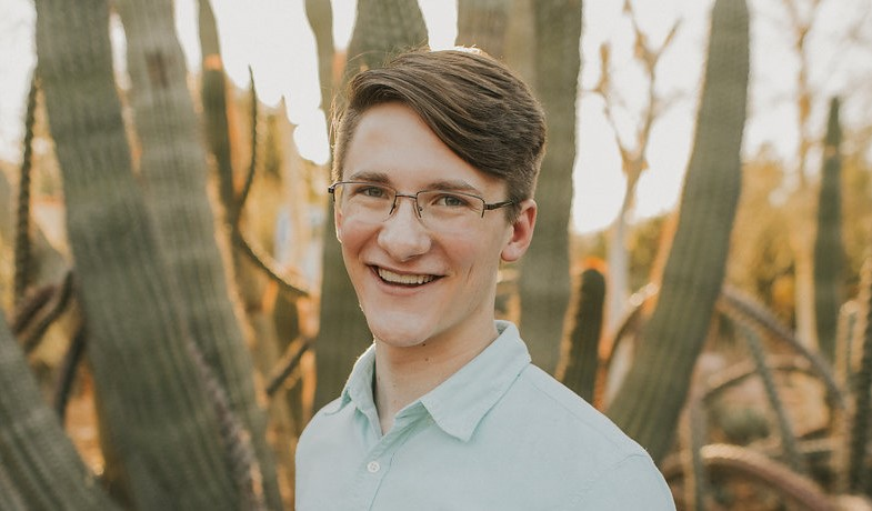 Udall Scholarship recipient Kyle Kline with ocotillo cactus in background