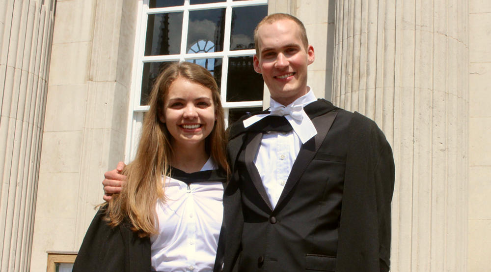 UA Honors alumni Travis Sawyer and Jeannie Wilkening at their graduation from the University of Cambridge