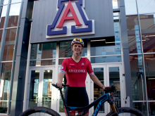 Honors student Spencer Ciammitti on his bike in front of the North Rec
