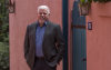 Honors Dean Terry Hunt - Standing outside by pink wall and green door