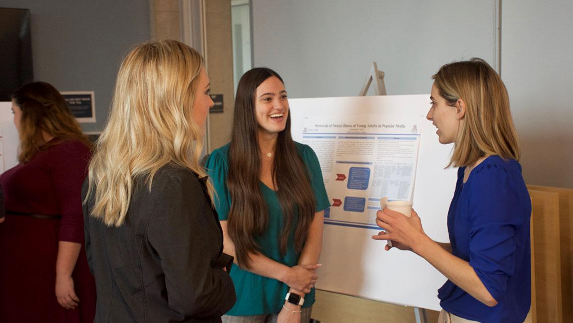 Students presenting at the Dec 2019 Poster Session