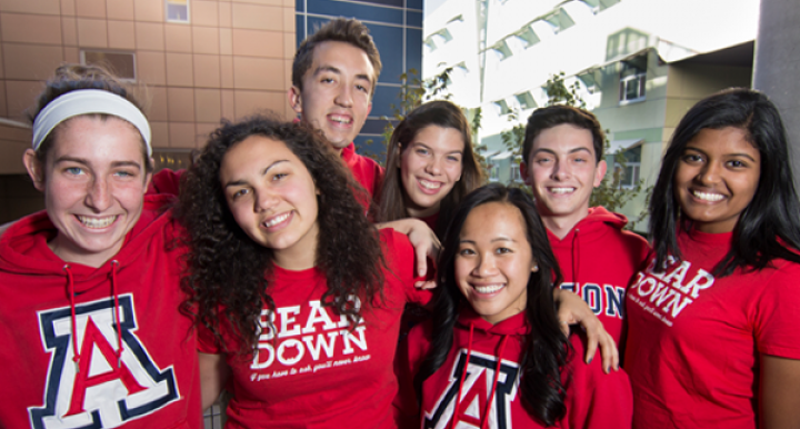 Group of seven Honors College students wearing UA gear.