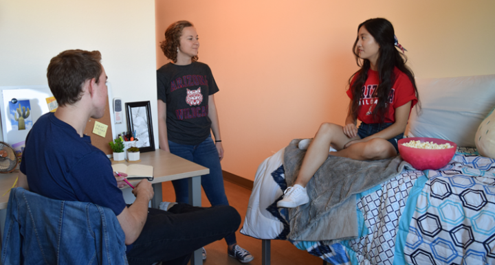 Students talking in the dorm in the Honors Village