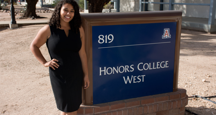 Leah Crowder in front of Honors College Sign