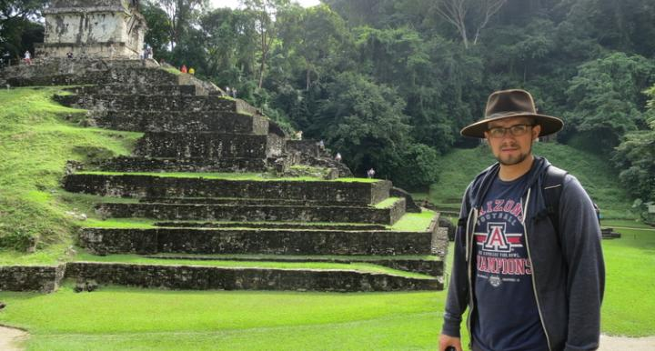 Photo of Anthony Polanco beside Mayan temple Palenque